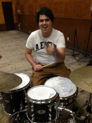 Gaston laying down a groove on Drums